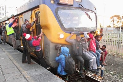 Commuters climbing on a Khayelitsha-bound train: According to the TomTom traffic index Cape Town is the most congested city in the country and 48th in the world, ahead of cities such as New York.