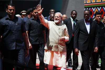 India's Prime Minister Narenda Modi escorted by AfDB president Akinwumi Adesina arrive at the opening ceremonies of the 2017 Annual Meetings of the African Development Bank (AfDB), which opened in Ahmedabad, India, on Tuesday, May 23, 2017. In his speech, prime minister Modi reiterated the centuries-old strong ties between India and Africa, noting that India's partnership with Africa is based on a model of cooperation that is responsive to the needs of Africa.