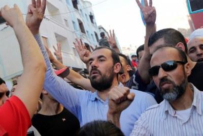 Nasser Zefzafi, leader de la contestation née dans le Rif après la mort d'un vendeur de poisson broyé par une benne à ordure, ici lors d'une manifesation le 18 mai 2017.