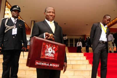 Finance minister Matia Kasiaja arrives at Serena Hotel in Kampala for the 2017/2018 National Budget reading on June 8, 2017.