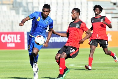 Banda Abdi of Tanzania challenged by Jabulani Linje of Malawi during the Cosafa Castle Cup match between Tanzania and Malawi at the Moruleng Stadium in Rustenburg on 25 June 2017.