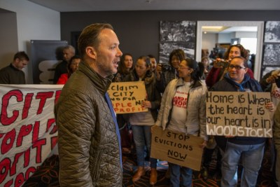Mayoral Committee Member for Urban Development Brett Herron speaks to supporters of Reclaim the City during the 4th annual Affordable Housing Africa Conference in Cape Town.