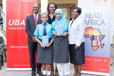 UBA Foundation takes its Read Africa Initiative East visiting Our Lady of our Mercy High School in Nairobi this week: Isaac Mwige, CEO UBA Kenya; Bola Atta, CEO UBA Foundation and Mrs Angwenyi, Principal of Our Lady of our Mercy with students of the school.