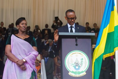 President Paul Kagame takes the presidential oath in the company of First Lady Jeannette Kagame (left) at Amahoro National Stadium in the capital Kigali.