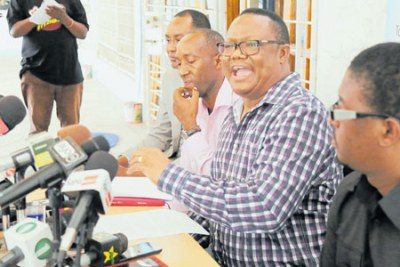 Tanganyika Law Society president Tundu Lissu addresses a news conference in Dar es Salaam.