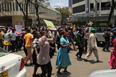 Nasa supporters march past City Hall as they head to Uhuru Park
