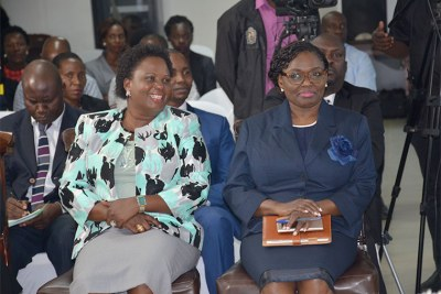 Lands minister Betty Amongi, left, with Lady Justice Catherine Bamugemereire during the launch of the inquiry earlier this year.