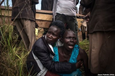 Sister  wails after the loss of a loved one in South Sudan conflict.