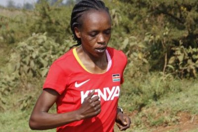 London Marathon and Olympic champion Jemimah Sumgong jogs during a past training session.