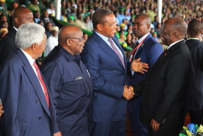 President John Magufuli shares a light moment with his predecessor Mr Jakaya Kikwete during the 56th Independence Day celebrations held at Jamhuri Stadium in Dodoma, yesterday. Looking on are former Presidents Benjamin Mkapa and Alhaj Ali Hassan Mwinyi (left)