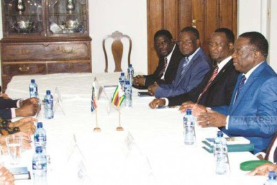 President Emmerson Mnangagwa, flanked by Zimbabwe's Ambassador to South Africa Cde Isaac Moyo (third from left), Foreign Affairs and International Trade Minister Retired Lieutenant-General Sibusiso Busi Moyo (right), Transport and Infrastructural Development Minister Joram Gumbo (second from left), and Industry, Commerce and Enterprise Development Minister Mike Bimha, meets his South African counterpart President Jacob Zuma and government officials at the Zimbabwe Embassy in Pretoria, South Africa, yesterday.