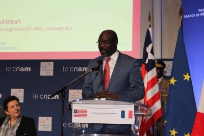 President George Weah delivering a speech in Paris.