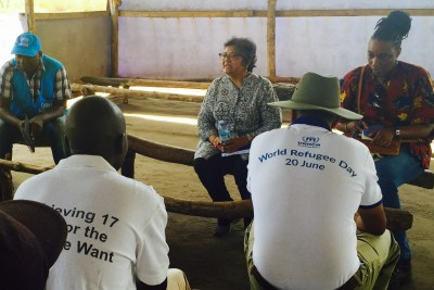 Yasmin Sooka, who chaired the Commission on Human Rights in South Sudan speaks with refugees at the Palabek refugee settlement in Uganda.