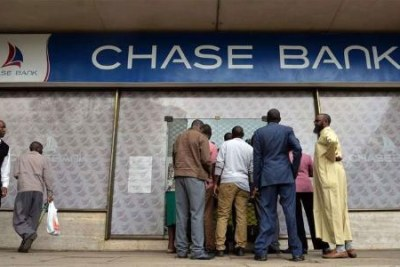 Customers at a Chase Bank branch.