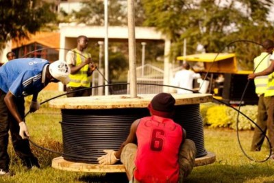 Telecom workers install fibre optic cables in Kigali. Liquid Telecom, a regional data, voice and IP service provider, has a mission of spreading reliable internet access to homes across Kigali.