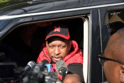 Nairobi Governor Mike Sonko talking to journalists from his car as he leaves Milimani Courts on May 9, 2018.