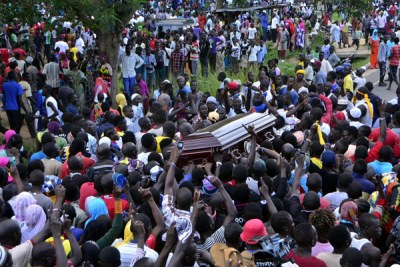 Mourners carry the casket bearing the remains of Ibrahim Abiriga in Arua town.