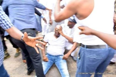 Ayodele Fayose, Ekiti State Governor - A photograph showing Ekiti State Governor, Chief Ayodele Fayose on the ground after he was attacked with tear gas and beaten by security operatives