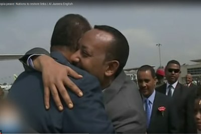PM Abiy Ahmed and Eritrea's President Isaias Afwerki embrace on his arrival at the airport.