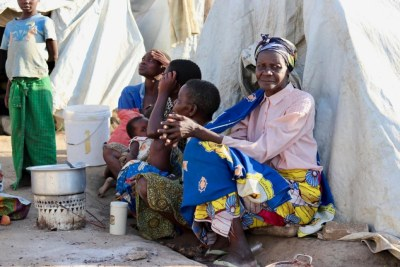 Women and children rest against a tent in the General Hospital site in a makeshift site in Bunia, in Ituri province (file photo)