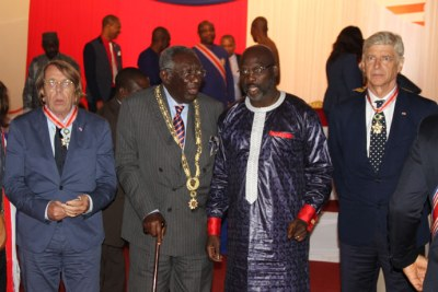 Claude Marie Francois Le Roy, John Kofi Agyekum Kufuor and Arsene Wenger with President George Weah at the investiture ceremony.