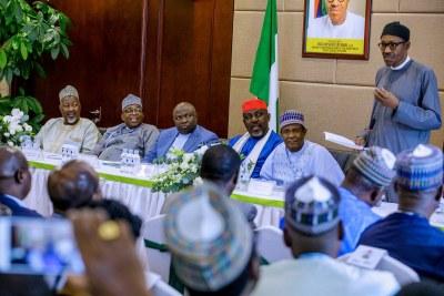 Buhari addressing Nigeria community in China.