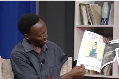 Patrick Gihana with his book Humura Mwana.