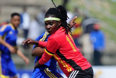 Hasifah Nassuna of Uganda is challenged by Nombuso Mamba of Swaziland during the 2018 Cosafa Womens Championship game between Swaziland and Uganda at Wolfson Stadium in Port Elizabeth on 12 September 2018.