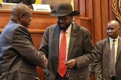 South Sudanese President Salva Kiir (right) shakes hands with his rival, Riek Machar, in Addis Ababa, Ethiopia on September 12, 2018.