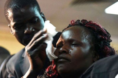 Sharon Otieno's parents Melida Auma and Douglas Otieno at the Milimani court in Nairobi.