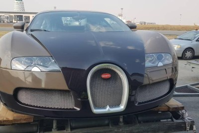 A U.S.$3 million Bugatti Veyron Fbg par Hermès lands at Robert Mugabe International Airport in Harare, Zimbabwe.