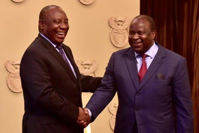 President Cyril Ramaphosa congratulates new finance minister Tito Mboweni after his swearing-in (file photo).