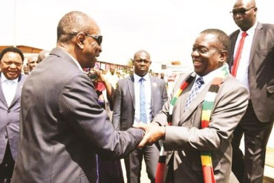 President Emmerson Mnangagwa is welcomed by Guinea President Alpha Condé on arrival at Airport Conakry Gbessia.