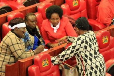 Some MPs hold a discussion during the debate on the Constitution of Kenya (Amendment) Bill (file photo).