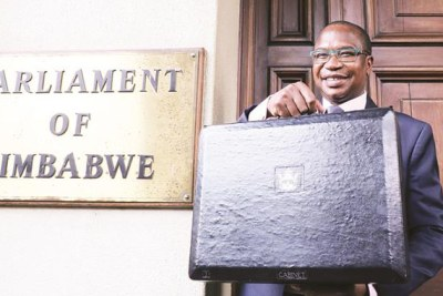 Finance and Economic Development Minister Professor Mthuli Ncube poses for a photograph with his briefcase before presenting his 2019 National Budget proposals in Parliament.