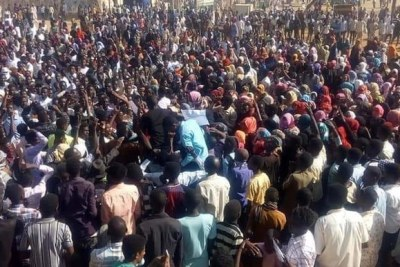 A crowd protests the skyrocketed bread and fuel prices, among others, in El Gezira Aba in White Nile state, on December 21.