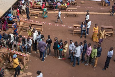 Voters lining up in front of polling stations during Presidential and Legislative elections in the Democratic Republic of the Congo