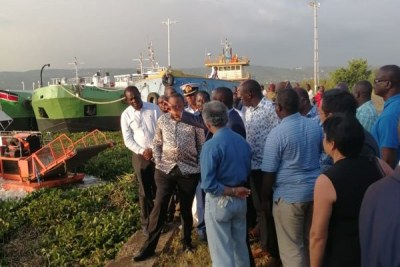 President Uhuru Kenyatta with ODM leader Raila Odinga and other officials during a tour of the Port of Kisumu.