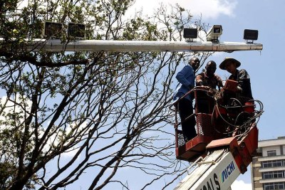 Nanjing Les Information Technology Company technicians install CCTV cameras along Kimathi Street on November 1, 2013.