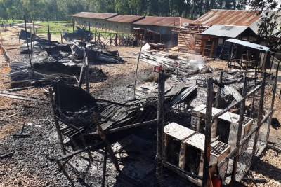 Burned structures are seen after attackers set fire to an Ebola treatment centre run by Medecins Sans Frontieres in Katwa, Democratic Republic of Congo.