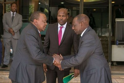 President Uhuru Kenyatta with his private secretary Jomo Gechaga and Deputy President William Ruto during their meeting at the DP's Harambee House Annex office in Nairobi, March 26, 2019.