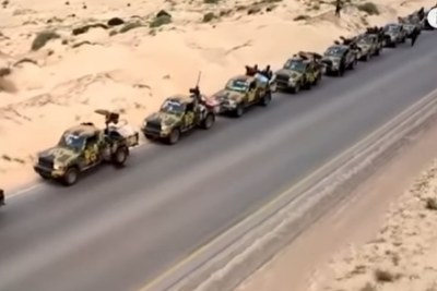 Libya National Army vehicles on a road in Libya.