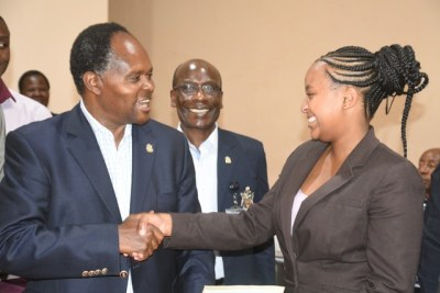Ann Mwangi Mvurya, the new chairperson of the University of Nairobi Students Association with Vice-Chancellor Peter Mbithi.