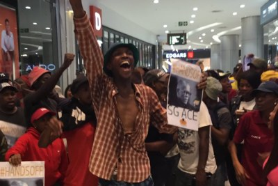 Protesters at the Sandton launch of Pieter-Louis Myburgh's book Gangster State: unravelling Ace Magashule's Web of Capture.