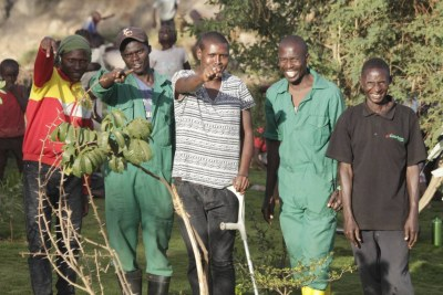 Members of Komb Green Solutions pose for a picture in Korogocho, Kenya on March 27, 2019.