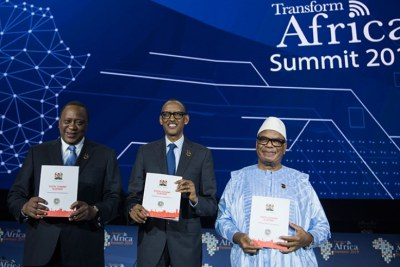 President Paul Kagame, and his counterparts Uhuru Kenyatta of Kenya (left), and Ibrahim Boubacar Keïta of Mali pose with copies of Kenyan government's 'Digital Economy Blueprint' on the first day of the 5th Transform Africa Summit in Kigali.