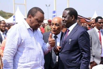 President Uhuru Kenyatta (left) converses with ODM leader Raila Odinga (right) during the opening of Bidco Industrial Park in Kiambu on July 25, 2019.