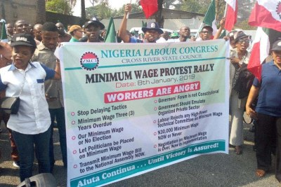 File photo of members of the Nigeria Labour Congress protesting over non-implementation of the new minimum wage in Calabar.