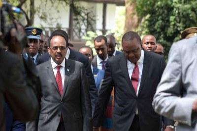 President Uhuru Kenyatta with his Somalia counterpart Mohamed Abdullahi Farmajo after the National Prayer Breakfast at Safari Park Hotel in Nairobi (file photo).