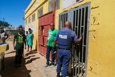 South African Police shut down spaza shops in Govan Mbeki Township in Port Elizabeth, South Africa.